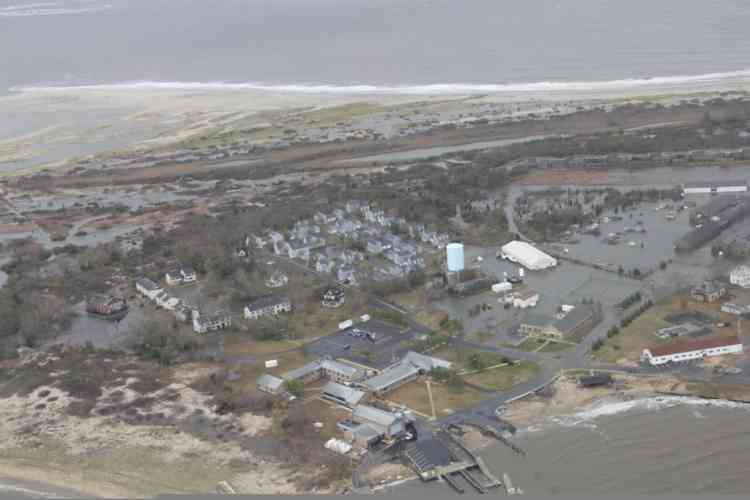"""Damage after Hurricane Sandy made landfall on the southern New Jersey coastline is seen in this U.S. Coast Guard handout photo in Brigantine, New Jersey, October 30, 2012. In the storm's wake, Obama issued federal emergency decrees for New York and New Jersey, declaring that """"major disasters"""" existed in both states. One disaster-forecasting company predicted economic losses could ultimately reach $20 billion (12.4 billion pounds), only half insured.  REUTERS/U.S.Coast Guard/Petty Officer 2nd Class Erik Swanson/Handout  (UNITED STATES - Tags: ENVIRONMENT DISASTER) FOR EDITORIAL USE ONLY. NOT FOR SALE FOR MARKETING OR ADVERTISING CAMPAIGNS. THIS IMAGE HAS BEEN SUPPLIED BY A THIRD PARTY. IT IS DISTRIBUTED, EXACTLY AS RECEIVED BY REUTERS, AS A SERVICE TO CLIENTS"""