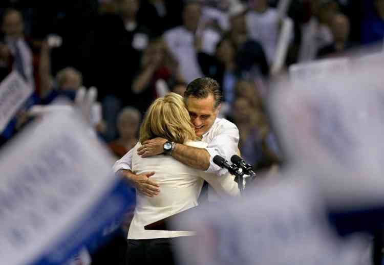 Republican presidential candidate, former Massachusetts Gov. Mitt Romney, right, embraces his wife Ann, as they take the stage before he speaks at a campaign event at the Verizon Wireless Arena, Monday, Nov. 5, 2012, in Manchester, N.H. (AP Photo/David Goldman)