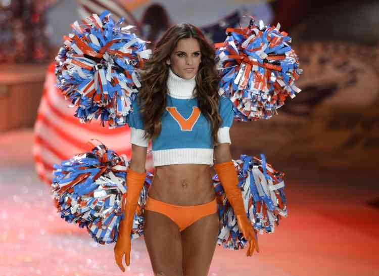 A model wears a cheerleader outfit during the 2012 Victoria's Secret fashion show November 7, 2012 in New York. AFP PHOTO/TIMOTHY A. CLARY