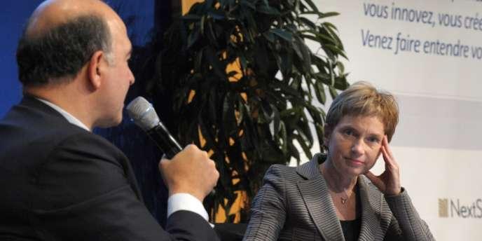 Pierre Moscovici et Laurence Parisot, à Paris, le 12 novembre.
