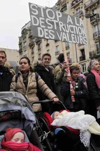 Demonstrators protest against French President Francois Hollande's plan to legalize marriage and adoption for gay people, in Paris, Saturday Nov. 17, 2012. Saturday's event, entitled