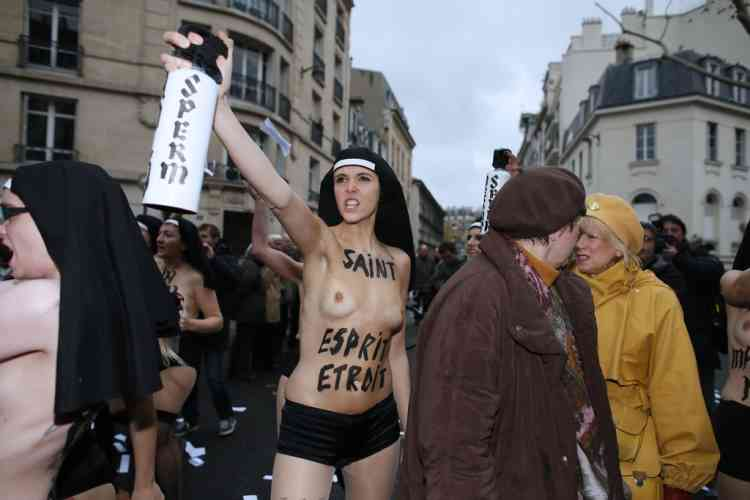 Topless activists of the Ukrainian women movement Femen take part in a protest against the fierce opposition from the Roman Catholic Church to authorise gay marriage on November 18, 2012 in Paris.   AFP PHOTO KENZO TRIBOUILLARD