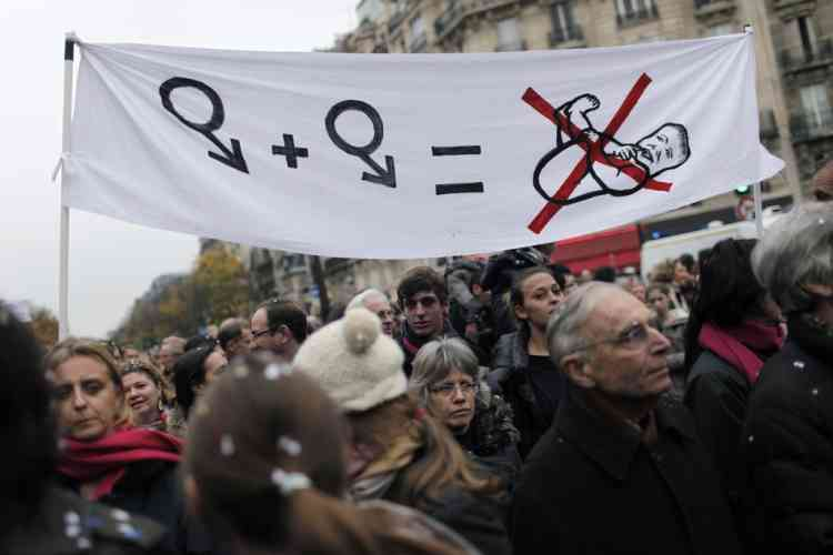 """Demonstrators protest against French President Francois Hollande's plan to legalize marriage and adoption for gay people, in Paris, Saturday Nov. 17, 2012. Saturday's event, entitled """"march for everyone"""", attracted several thousand people in cities such as Lyon, Marseille and Paris.  (AP Photo/Thibault Camus)"""