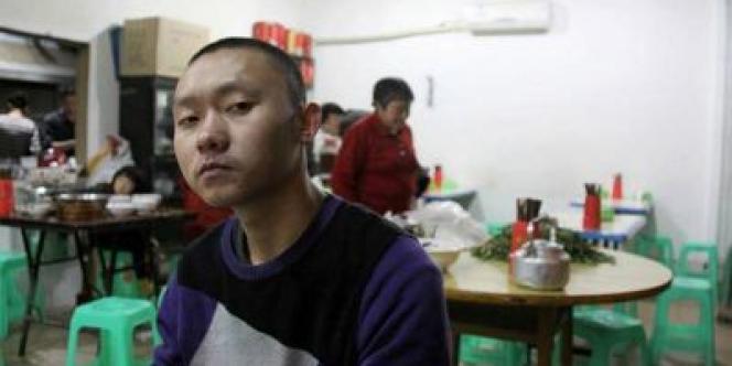 Ren Jianyu dans une salle de restaurant de Chongqing, le 19 novembre.