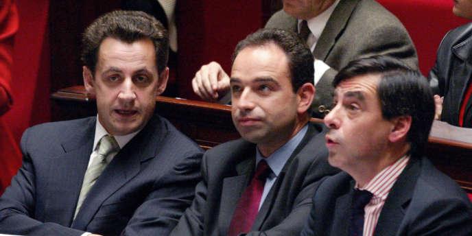 Nicolas Sarkozy, Jean-François Copé et François Fillon le 9 octobre 2002 dans les rangs de l'Assemblée nationale.