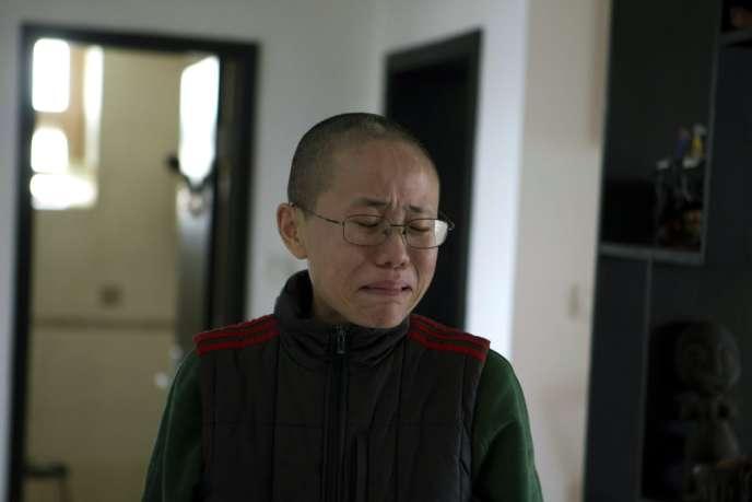 Liu Xia, femme du prix Nobel de la paix en 2010 Liu Xiaobo, le 6 décembre à Pékin, alors qu'elle reçoit la visite inopinée de journalistes de l'Associated Press.