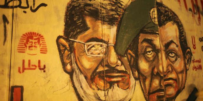 Les islamistes n'ont su régler aucun problème structurel. Arrivés au pouvoir, ils ont donné l'impression d'une impéritie et d'une incompétence chronique. Ici, des graffitis hostiles au président égyptien déchu Mohammed Morsi.