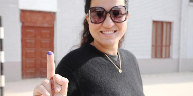 Cette jeune femme a voté dans le quartier bourgeois de Garden City, samedi 15 décembre.