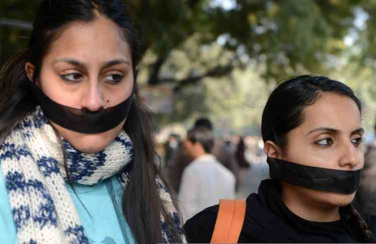 Indian students protestors pray for rape victim during a protest demanding better security for women in New Delhi on December 29, 2012, as Indian leaders appealled for calm fearing fresh outbursts of protests after the death of a gang-rape student victim. New Delhi's top police officer and chief minister have urged people to mourn the death of a gang-rape victim in a peaceful manner as large parts of the city-centre were sealed off. The calls for calm came after an Indian woman who was gang-raped on a New Delhi bus died in a Singapore hospital after suffering severe organ failure. AFP PHOTO/RAVEENDRAN