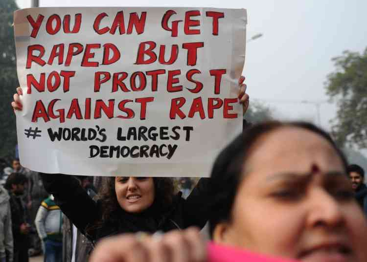 TOPSHOTS  Indian demonstrators shout slogans and wave placards as they move towards India Gate in New Delhi on December 27, 2012, during a protest calling for better safety for women following the rape of a student in the Indian capital. Protests across India over the last week against sex crimes have denounced the police and government, with the largest in New Delhi at the weekend prompting officers to cordon off areas around government buildings. One policeman was killed and more than 100 people injured in the violence.  AFP PHOTO/SAJJAD HUSSAIN