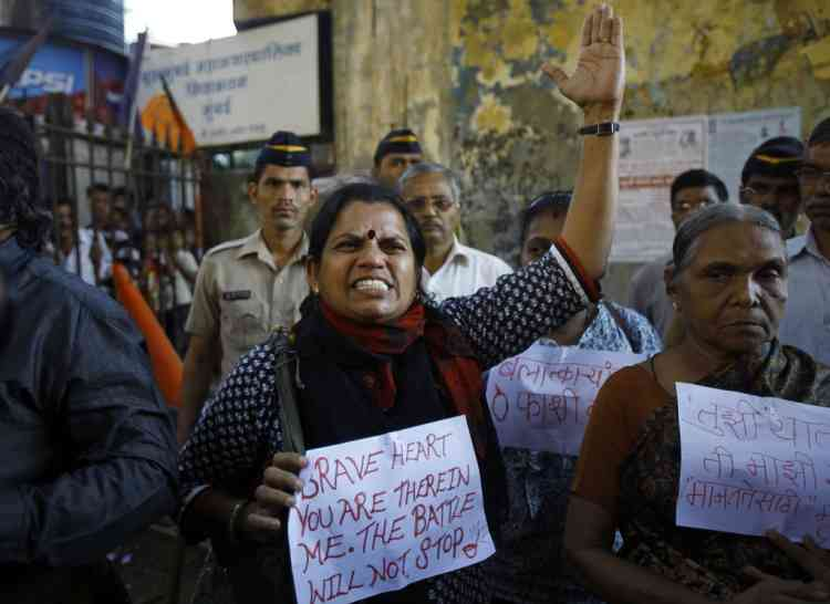 An Indian woman shouts at a police officer during a gathering of people to mourn the death of the 23-year-old gang rape victim in Mumbai, India, Saturday, Dec. 29, 2012. The young Indian woman who was gang-raped and severely beaten on a bus in New Delhi died Saturday at a Singapore hospital, after her ordeal galvanized Indians to demand greater protection for women from sexual violence that impacts thousands of them every day. (AP Photo/Rafiq Maqbool)