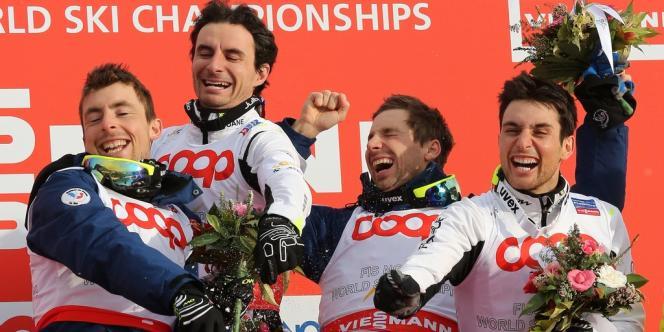 Francois Braud, Sebastien Lacroix,  Jason Lamy-Chappuis et Maxime Laheurte, dimanche, à Tesero (Italie) après leur titre mondial par équipe.