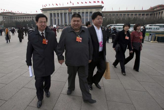Mao Xinyu (au centre), petit-fils de Mao Zedong.