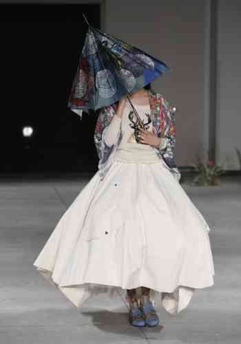 A model displays a creation by British designer Steven Hall and Japanese designer Yurika Ohara during the 2013-2014 autumn/winter Collection at the Tokyo Fashion Week in Tokyo, Tuesday, March 19, 2013. (AP Photo/Shizuo Kambayashi)