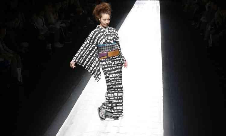 A model displays a creation by Japanese designer Jotaro Saito during the 2013-2014 autumn/winter Collection at the Tokyo Fashion Week in Tokyo, Tuesday, March 19, 2013. (AP Photo/Shizuo Kambayashi)
