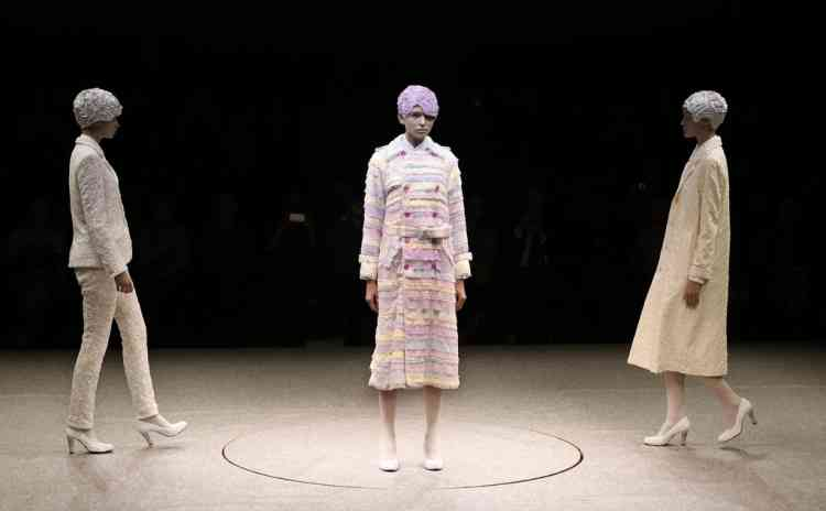 Models display creations by Japanese designer Kunihiko Morinaga during the 2013-2014 autumn/winter Collection at the Tokyo Fashion Week in Tokyo, Tuesday, March 19, 2013. (AP Photo/Shizuo Kambayashi)