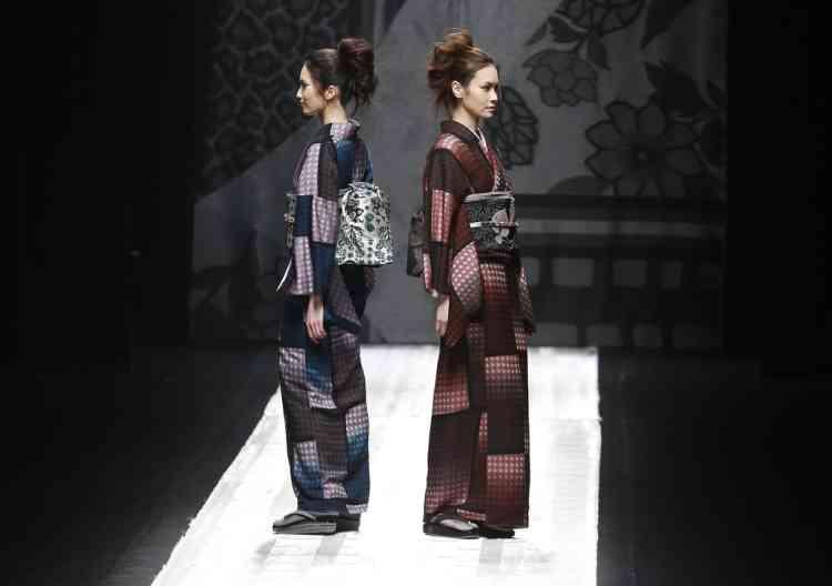 Models display creations by Japanese designer Jotaro Saito during the 2013-2014 autumn/winter Collection at the Tokyo Fashion Week in Tokyo, Tuesday, March 19, 2013. (AP Photo/Shizuo Kambayashi)