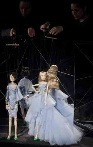 Puppets, about 30 inches high, wearing miniature versions of designs from the Fause Haten summer collection are presented during Sao Paulo Fashion Week in Sao Paulo, Brazil, Wednesday, March 20, 2013. (AP Photo/Andre Penner)