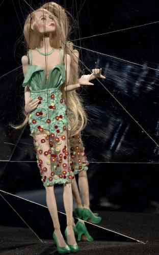 A puppet, about 30 inches high, wearing a miniature version of a design from the Fause Haten summer collection is presented during Sao Paulo Fashion Week in Sao Paulo, Brazil, Wednesday, March 20, 2013. (AP Photo/Andre Penner)
