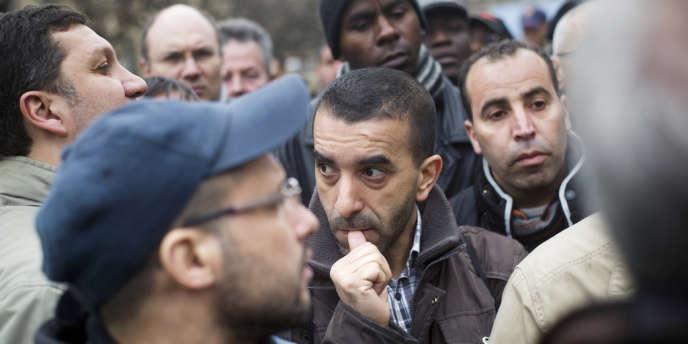 Des ouvriers PSA de l'usine d'Aulnay manifestent le 11 avril à Paris.