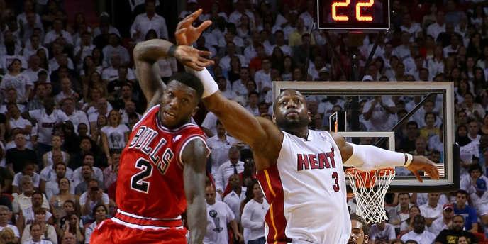 Nate Robinson face à Dwyane Wade, le 8 mai à Miami.