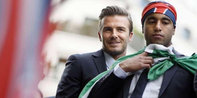 David Beckham, à gauche aux côtés de Lucas Moura, le 13 mai à Paris.