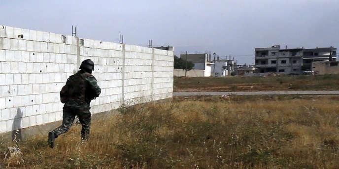 Un soldat syrien à Qoussair, le 23 mai 2013.