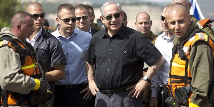 Le premier ministre israélien Benyamin Nétanyahou lors d'un exercice de défense à Jérusalem, mercredi 29 mai 2013.