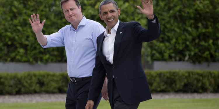 British Prime Minister David Cameron welcomes President Barack Obama to the G-8 summit in Enniskillen, Northern Ireland,  on Monday, June 17, 2013. Leaders are expected to discuss the ongoing conflict in Syria, and free-trade issues. (AP Photo/Evan Vucci)