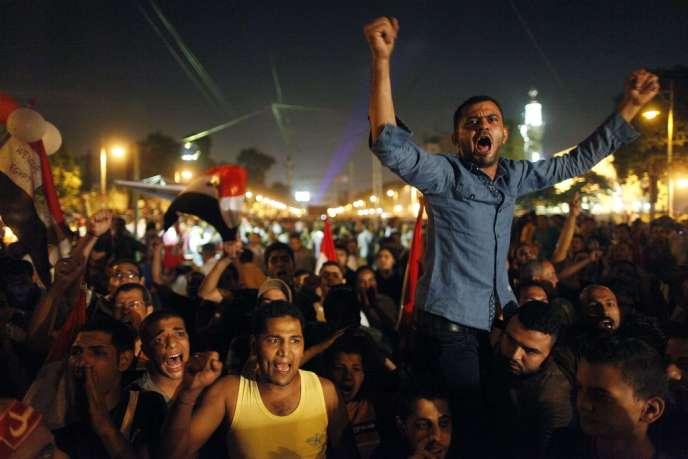 Lors d'une manifestation pour réclamer le départ du président Morsi, le 3 juillet, au Caire.