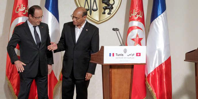Voyage d'Etat du président François Hollande en Tunisie. Conférence de presse avec le président Moncef Marzouki au Palais de Carthage, jeudi 4 juillet 2013.