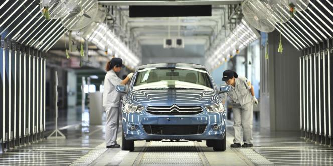 Usine DPCA (Dongfeng Peugeot Citroën Automobile), dans la province du Hubei, le 2 juillet 2013.