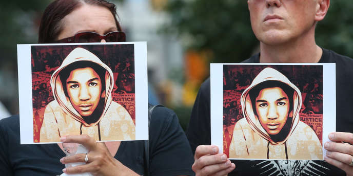 Des centaines de personnes ont défilé à New York dimanche 14juillet 2013 pour protester contre l'acquittement de George Zimmerman, accusé du meurtre du jeune Noir Trayvon Martin.