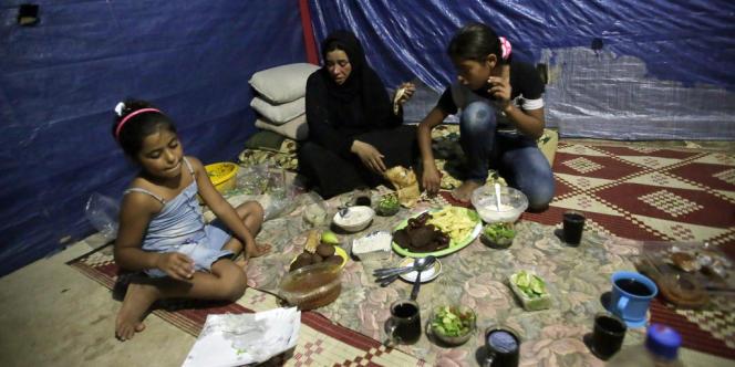 Fatima, réfugiée syrienne à Tripoli, au Liban, avec ses enfants, a perdu son mari dans les combats à Homs.