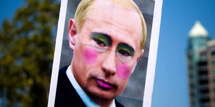 A sign is displayed of a defaced picture of Russia's President Vladimir Putin during Vancouver's 35th annual Pride Parade in Vancouver, British Columbia August 4, 2013.   REUTERS/Ben Nelms    (CANADA - Tags: SOCIETY)