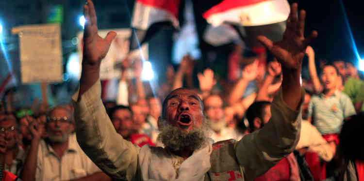 A supporter of Egypt's ousted President Mohammed Morsi chants slogans during a protest outside Rabaah al-Adawiya mosque, where protesters have installed a camp and hold daily rallies at Nasr City in Cairo, Egypt, Sunday, Aug. 4, 2013. (AP Photo/Khalil Hamra)