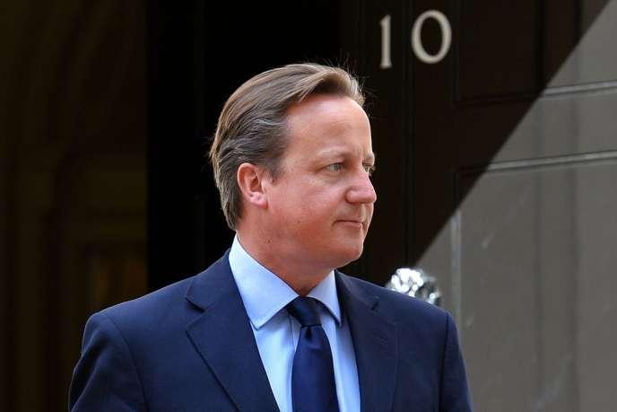 David Cameron, le 6 août 2013, devant le 10 Downing Street, à Londres.