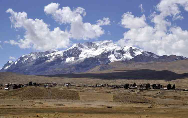 Picture taken on August 15, 2013 of the community of Frasquia, 4050 metres above sea level, on the foothills of the Illampu snowcapped mountain in the Bolivian Andes, some 150 km east of La Paz, where Bolivian Carmelo Flores Laura, an Aymara native who claims is 123 years old and if confirmed would be the oldest man alive, lives. The Bolivian Government will check documents that say Flores was born on July 16, 1890 to verify if he indeed is the oldest living person.   AFP PHOTO / Aizar RALDES
