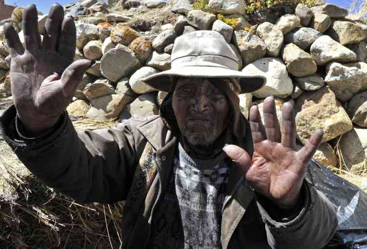 Bolivian Carmelo Flores Laura, an Aymara native who claims is 123 years old and if confirmed would be the oldest man alive, gestures in the community of Frasquia, 4050 metres above sea level, on the foothills of the Illampu snowcapped mountain in the Bolivian Andes, some 150 km east of La Paz, on August 15, 2013. The Bolivian Government will check documents that say Flores was born on July 16, 1890 to verify if he indeed is the oldest living person.   AFP PHOTO / Aizar RALDES