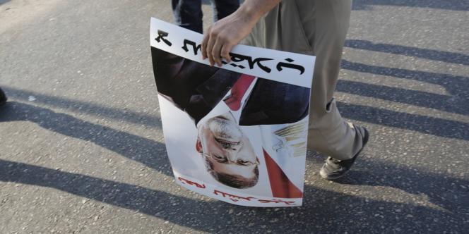 Un partisan du président déchu Mohamed Morsi lors d'une manifestation au Caire le 18 août.
