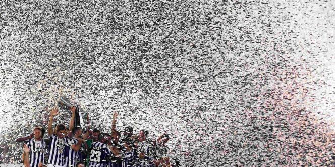 Les joueurs de la Juventus de Turin célèbrent leur victoire en finale de la Supercoupe d'Italie en août 2013.