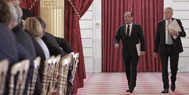 François Hollande et Jean-Marc Ayrault, dans la salle des fêtes de l'Elysée, le 19 août.