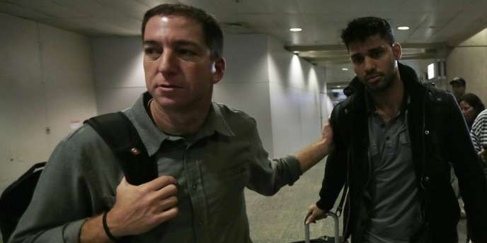 Le journaliste Glenn Greenwald (à gauche) est allé chercher son compagnon David Miranda à l'aéroport de Rio de Janeiro, après que ce dernier a été interrogé pendant neuf heures à l'aéroport d'Heathrow à Londres.