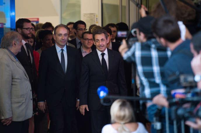 Jean-François Copé et Nicolas Sarkozy au siège de l'UMP, à Paris, le 8 juillet.