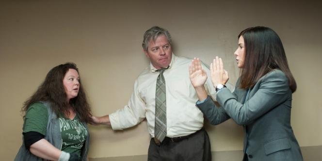 Melissa McCarthy, Thomas F. Wilson et Sandra Bullock dans