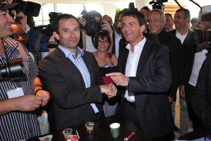 Les ministres Benoît Hamon et Manuel Valls, ici à La Rochelle en août 2012, réuniront chacun leurs partisans respectifs lors de l'édition 2013 de l'université d'été du PS.