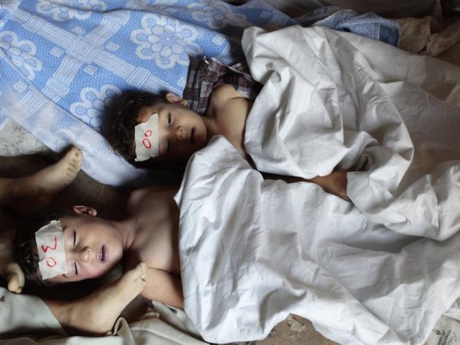 Enfants tués par des gaz toxiques, le 21 août, à la Ghouta, un faubourg de Damas.