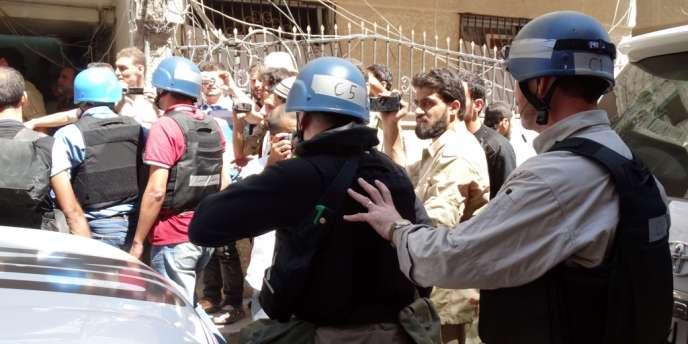 L'équipe d'experts en armes chimiques de l'ONU dans le quartier de Ghouta le 28 août.