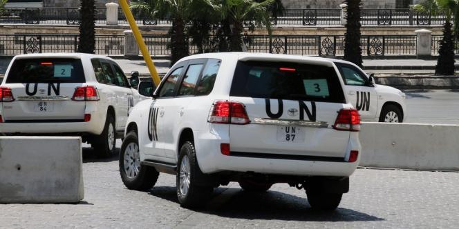 Les inspecteurs de l'ONU quittent leur hôtel à Damas, le 30 août.