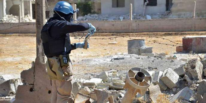 Un enquêteur de l'ONU sur les lieux d'une attaque à l'arme chimique, le 28 août.
